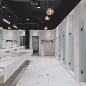 luxurious gym bathroom showers and sinks