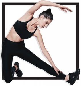woman stretching in fitness attire
