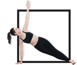 woman model in fitness apparel reaching for sky while resting on one arm with legs straight