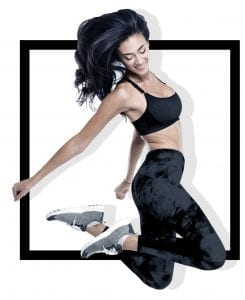 woman model in fitness apparel jumping up